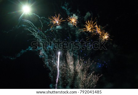 Beautiful and colorful fireworks for the New Year with the moon.