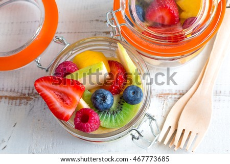 Beautiful and colorful fresh fruit salad in little jars to take away