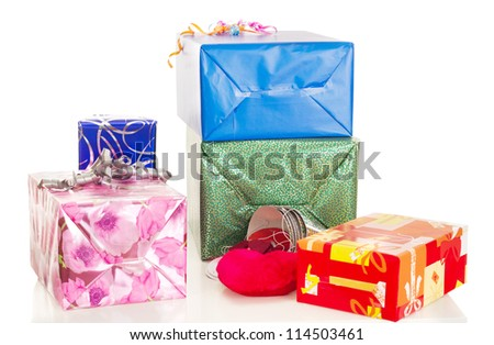 Beautiful and colorful gifts on the table - stock photo