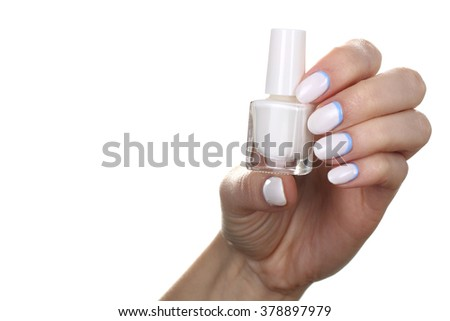 beautiful and colorful nail Polish in the hand of the woman isolated on white background
