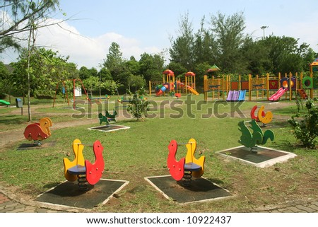 Beautiful and colorful playground on a quiet sunny day - stock photo