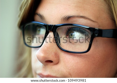 Beautiful and Confident Business Woman Wearing Eye Glasses Side View - stock photo