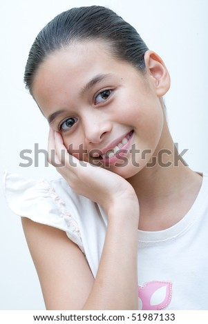 Beautiful and confident young girl of Asian and European background - stock photo
