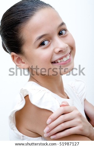 Beautiful and confident young girl of mix parentage - stock photo
