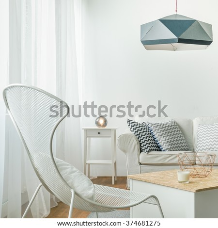 Beautiful and cozy living room in the apartment - stock photo