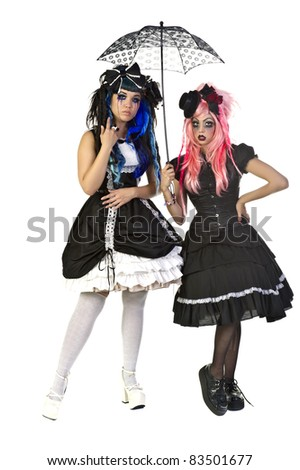 Beautiful and dark Gothic and Lolita doll characters - stock photo