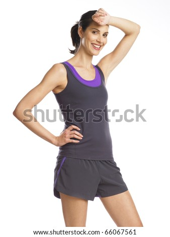 Beautiful and determined young woman after workout - stock photo