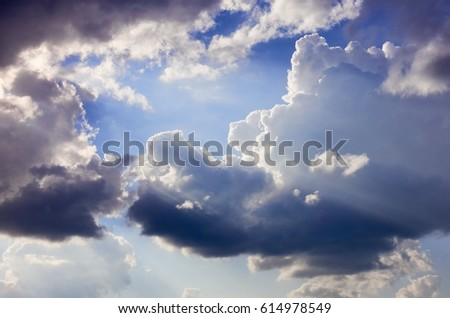 Beautiful and dramatic cloud formation and sun rays just before the rain in summer