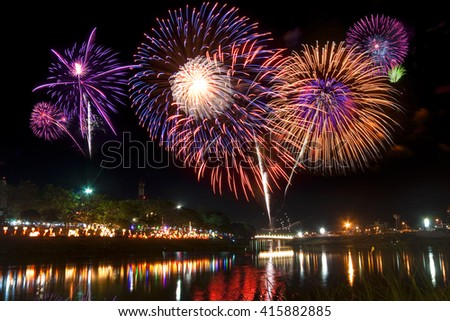 Beautiful and fantastic firework display for celebration on the river. - stock photo