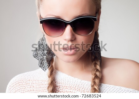 beautiful and fashion girl in sunglasses, close-up portrait - stock photo