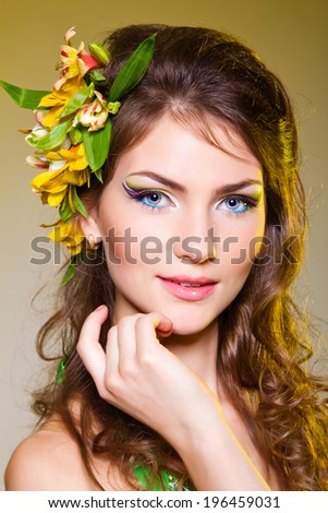 Beautiful and Fashion Sexy young woman with  flowers on her long hair.  - stock photo