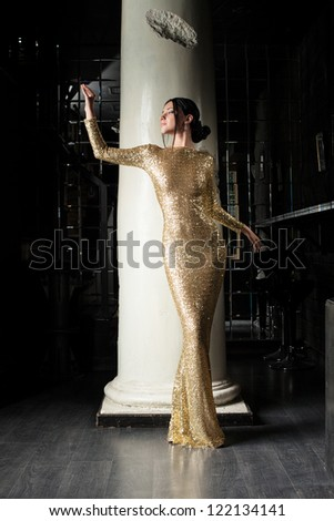 Beautiful and fashion woman in gold dress