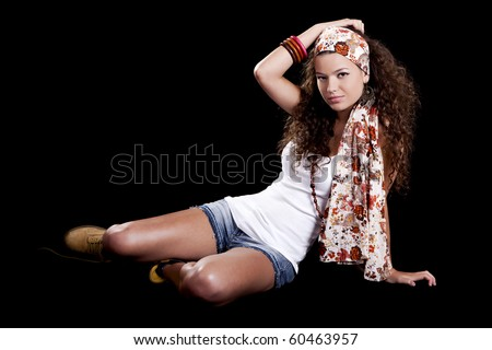 Beautiful and fashion young woman isolated on a black background - stock photo
