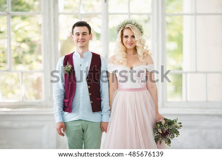 Beautiful and happy couple standing together