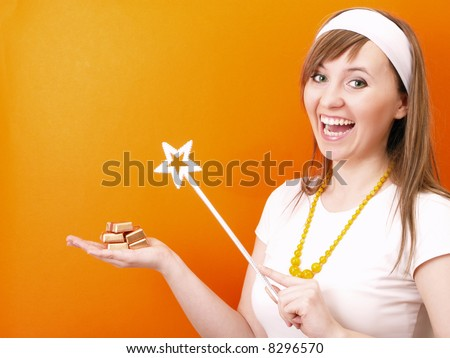 Beautiful and happy fairy with wand in the hand. - stock photo
