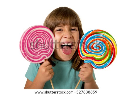 beautiful and happy female child having fun eating big lollipop spiral candy with  funny face expression isolated on white background in kid sugar abuse and excess concept - stock photo