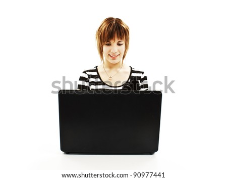 Beautiful and happy girl with a laptop. Isolated on white background - stock photo