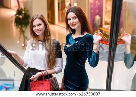 Beautiful And Happy Girls Are Shopping At The Mall