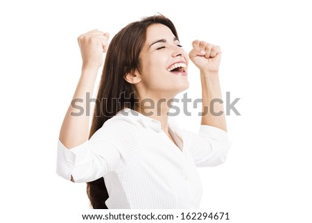 Beautiful and happy hispanic business woman with arms up, isolated over a white background - stock photo