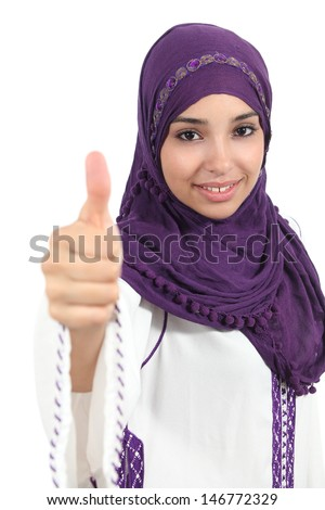 Beautiful and happy muslim woman wearing a hijab with thumb up isolated on a white background               - stock photo