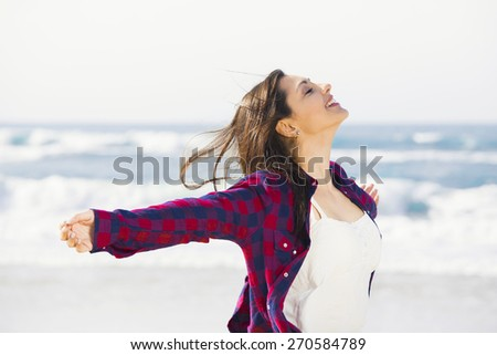 Beautiful and happy teen at the beach enjoying the summer - stock photo