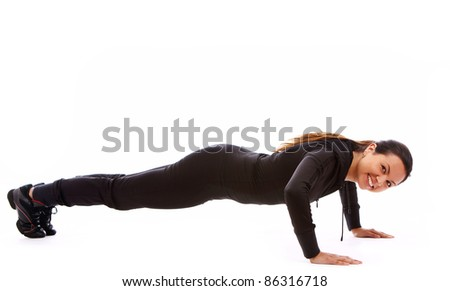 Beautiful and happy woman doing fitness exercises isolated over white - stock photo