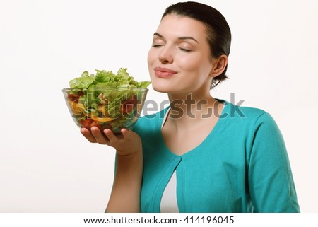 Beautiful and happy woman holding a delicious salad. Fresh vegetables, healthy diet. - stock photo