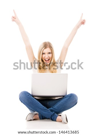 Beautiful and happy woman with a laptop and arms up, isolated over white background - stock photo
