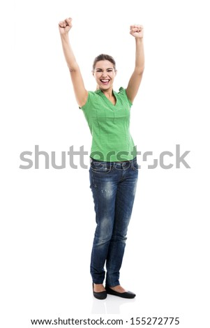 Beautiful and happy woman with arms up, isolated over a white background - stock photo