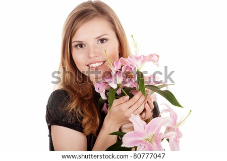 Beautiful and happy woman with flowers