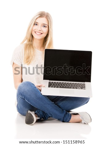 Beautiful and happy woman working with a laptop, isolated over white background - stock photo