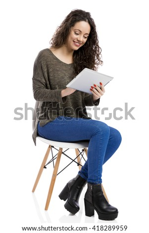 Beautiful and happy woman working with a tablet, isolated over white background  - stock photo