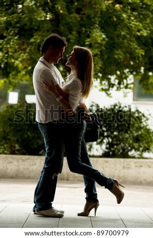 Beautiful and happy young couple in love - stock photo
