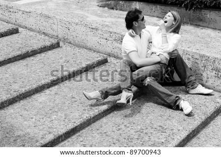 Beautiful and happy young couple in love having fun together - stock photo