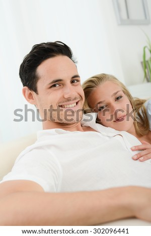 beautiful and happy young couple in love relaxed at home
