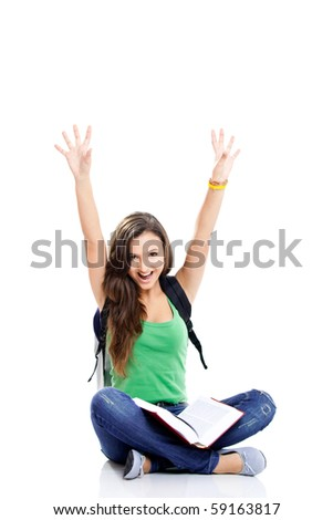 Beautiful and happy young female student with arms raised, isolated on white