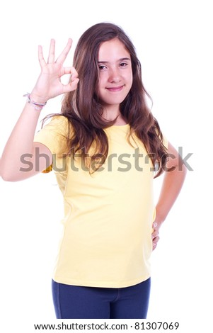 Beautiful and happy young girl doing Ok gesture - stock photo