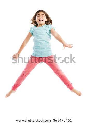 Beautiful and happy young girl jumping  - stock photo