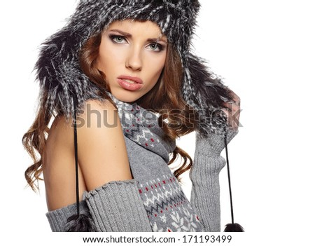 Beautiful and happy young woman isolated on white and wearing a fur hat  - stock photo