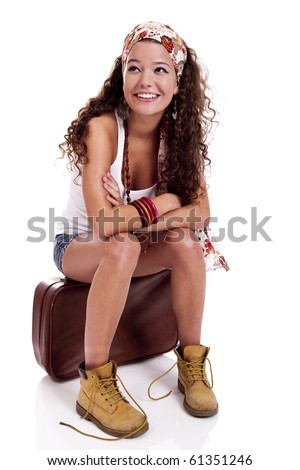 Beautiful and happy young woman with a old suitcase, isolated on white background - stock photo