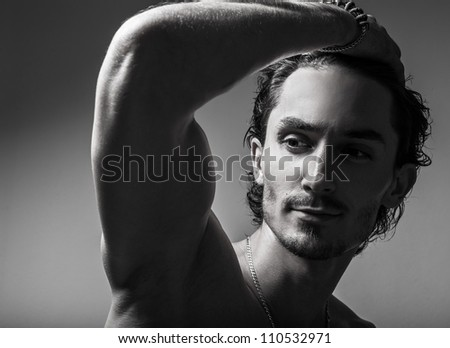 Beautiful and health athletic caucasian muscular young man. Black-white photo. - stock photo