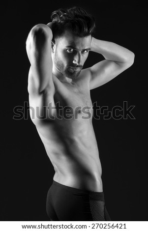 Beautiful and health athletic muscular young man. - stock photo