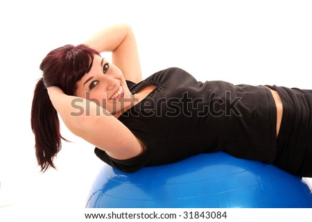 Beautiful and healthy fitness girl on a blue exercise ball
