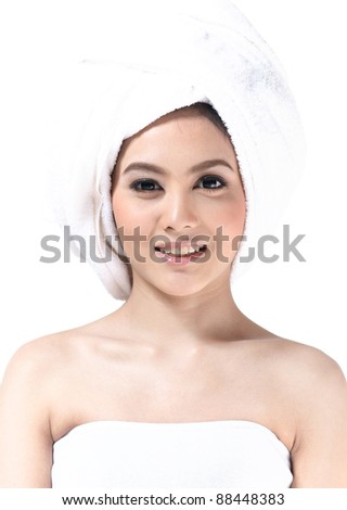 Beautiful and healthy young asian woman wearing towel on her head - stock photo