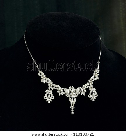 Beautiful and luxury diamond necklace on black stand - stock photo