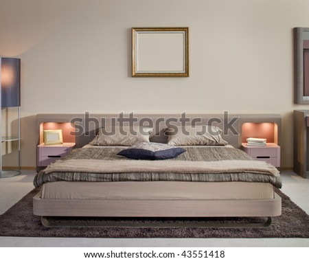 Beautiful and modern bedroom interior design. Hotel and home furnishing. - stock photo