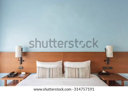 Beautiful and modern bedroom with empty wall for add some text, logo, image, etc. - stock photo