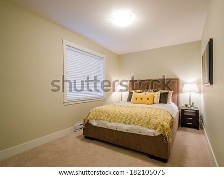 Beautiful and modern yellow bedroom in a home hotel. Interior design.