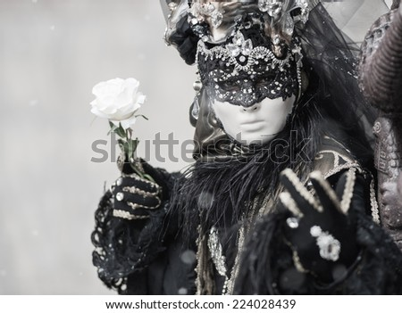 beautiful and mysterious portrait of a mask during venice carnival - italy - stock photo