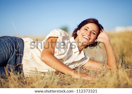 Beautiful and natural adult woman outdoors - stock photo